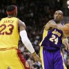Los Angeles Lakers\' Kobe Bryant (24) fires a pass around Cleveland Cavaliers\' LeBron James (23) during the third quarter of an NBA basketball game Sunday, Feb. 8, 2009, in Cleveland. The Lakers beat the Cavaliers 101-91. (AP Photo/Mark Duncan) ORG XMIT: OHMD112
