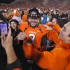 Oklahoma State\'s Brandon Weeden (3) celebrates with fans after the 44-10 win over Oklahoma during the Bedlam college football game between the Oklahoma State University Cowboys (OSU) and the University of Oklahoma Sooners (OU) at Boone Pickens Stadium in Stillwater, Okla., Saturday, Dec. 3, 2011. Photo by Chris Landsberger, The Oklahoman