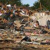 People pick through debris from a business in Woodward, Okla., Sunday, April 15, 2012. A tornado that killed five people struck Woodward, Okla., shortly after midnight on Sunday, April 15, 2012. Photo by Bryan Terry, The Oklahoman