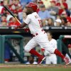 Photo - Phillies' Jimmy Rollins runs to first base after getting a hit in the first inning of a baseball game against the Miami Marlins, Monday, June 23, 2014. (AP Photo/The Philadelphia Daily News, Yong Kim)
