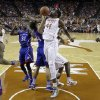 Texas\' Prince Ibeh (44) is blocked by Kansas\' Perry Ellis (34) as he tries to score during the first half of an NCAA college basketball game, Saturday, Jan. 19, 2013, in Austin, Texas. (AP Photo/Eric Gay)
