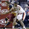 Photo - Portland Trail Blazers forward LaMarcus Aldridge, right, drives on Cleveland Cavaliers forward Tristan Thompson, from Canada, during the first half of an NBA basketball game in Portland, Ore., Wednesday, Jan. 15, 2014. (AP Photo/Don Ryan)