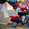 Micah Maloney, 13 months, rides his bike in the children\'s parade during the Yukon Freedom Fest at the Yukon City Park on Thursday , July 4, 2013, in Yukon, Okla. Photo by Chris Landsberger, The Oklahoman