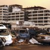 Destroyed vehicles are piled on top of one another in the parking lot of the Joplin Regional Medical Center in Joplin, Mo., Sunday, May 22, 2011. A large tornado moved through much of the city, damaging the hospital and hundreds of homes and businesses. (AP Photo/Mark Schiefelbein) ORG XMIT: MOMS107
