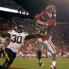 Oklahoma\'s Ryan Broyles (85) catches a touchdown pass beside Missouri\'s Kenronte Walker (30) during their game Saturday in Norman. OU won 38-28.Photo by Bryan Terry, The Oklahoman