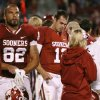 Oklahoma\'s Landry Jones (12) walks the sidelines during the college football game between the University of Oklahoma Sooners (OU) and the Texas Tech University Red Raiders (TTU) at Gaylord Family-Oklahoma Memorial Stadium in Norman, Okla., Sunday, Oct. 23, 2011. Oklahoma lost 41-38. Photo by Bryan Terry, The Oklahoman