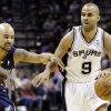 San Antonio Spurs\' Tony Parker (9), of France, works the ball around Memphis Grizzlies\' Jerryd Bayless (7) during the first quarter of an NBA basketball game, Wednesday, Jan. 16, 2013, in San Antonio. (AP Photo/Eric Gay)