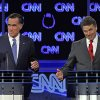 Photo -   FILE - In this Oct. 18, 2011, file photo Republican presidential candidates Mitt Romney and Rick Perry, right, spar during a Republican presidential debate in Las Vegas. Perry, still nursing wounds from his failed presidential campaign, did himself a world of good with his self-deprecating jokes at a dinner in Washington in March. First, he joked that his time as the GOP front-runner had been