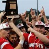 Hilldale players celebrate by hoisting the championship trophy after winning the Class 4A state high school baseball championship game at Shawnee High School\'s Memorial Park. on Saturday,, May 12, 2012. The Hilldale Hornets defeated the Berryhill Chiefs, 2-1. Photo by Jim Beckel, The Oklahoman