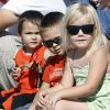 Two year old Emery Fowler, left, Payton Fowler, 4, and Paislee Wilson, 3, watch a parade during the Mustang Western Days celebration in Mustang, OK, Saturday, September 8, 2012, By Paul Hellstern, The Oklahoman
