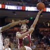 Oklahoma forward Tyler Neal (15) puts up a shot against Texas during the first half of an NCAA college basketball game, Saturday, Jan. 4, 2014, in Austin, Texas. (AP Photo/Michael Thomas)