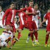 Germany\'s Benedikt Hoewedes, bottom, and Poland\'s Lukasz Szukala challenge for the ball during a friendly soccer match between Germany and Poland in Hamburg, Germany, Tuesday, May 13, 2014. (AP Photo/Matthias Schrader)