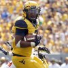 West Virginia\'s Charles Sims (3) rushes during the second half of a college football game between the Oklahoma State University and West Virginia University on Mountaineer Field at Milan Puskar Stadium in Morgantown, W. Va., Saturday, Sept. 28, 2013. Photo by Sarah Phipps, The Oklahoman