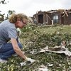 STORM DAMAGE / CLEANUP / AFTERMATH / HOUSE / CLEAN UP: Homeowner Donna Hensley gathers personal belongings scattered in the debris on Wednesday, May 12, 2010, in Oklahoma City, Okla. Hensley\'s home was destroyed by the tornados that hit central oklahoma on Monday. Photo by Chris Landsberger, The Oklahoman ORG XMIT: KOD