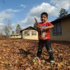 Diego Reyes, 5, plays outside of a cabin at the Methodist Camp on Caney Lake in Minden, La., Saturday Dec. 1, 2012. Authorities have begun moving 1 million pounds of improperly stored explosive powder to storage bunkers at the Camp Minden industrial site. State investigators found the explosives while inspecting property leased by Explo Systems, where an above-ground storage magazine exploded in October. (AP Photo/The Shreveport Times, Jim Hudelson) MAGS OUT; MANDATORY CREDIT SHREVEPORTTIMES.COM; NO SALES