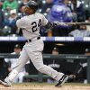 New York Yankees\' Robinson Cano follows the flight of his solo home run off Colorado Rockies relief pitcher Adam Ottavino in the fifth inning of a baseball game in Denver on Thursday, May 9, 2013. (AP Photo/David Zalubowski)