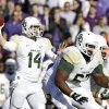 Photo - Baylor quarterback Bryce Petty (14) passes with protection from offensive linesman Desmine Hilliard (67) and other teammates during the first half of an NCAA college football game against TCU, Saturday, Nov. 30, 2013, in Fort Worth, Texas. (AP Photo/LM Otero)