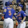 Photo - New York Mets' David Wright (5) is greeted by Daniel Murphy after hitting a two-run home run against the Miami Marlins in the fifth inning of a baseball game, Friday, July 11, 2014, in New York. (AP Photo/Julie Jacobson)