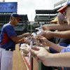 Photo - Texas Rangers' Yu Darvish of Japan signs autographs for fans before an opening day baseball game against the Philadelphia Phillies, Monday, March 31, 2014, in Arlington, Texas. (AP Photo/Tony Gutierrez)