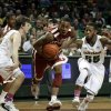 Baylor\'s Brady Heslip, left, and Pierre Jackson, defend as Oklahoma\'s Je\'lon Hornbeak (5) finds an opening to the basket during the first half of an NCAA college basketball game Wednesday, Jan. 30, 2013, in Waco, Texas. (AP Photo/Tony Gutierrez)