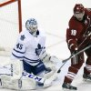 Photo - Toronto Maple Leafs goalie Jonathan Bernier (45) makes the save on Phoenix Coyotes right wing Shane Doan (19) in the second period of an NHL hockey game, Monday, Jan. 20, 2014, in Glendale, Ariz. (AP Photo/Rick Scuteri)