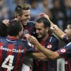 Photo - Julio Buffarini, top, of Argentina's San Lorenzo celebrates with teammates after their team defeated Brazil's Gremio during a Copa Libertadores soccer match in Porto Alegre, Brazil, Wednesday, April 30, 2014. San Lorenzo defeated Gremio in a penalty shootout. (AP Photo/Nabor Goulart)