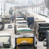 Cars and trucks are blocked after a heavy snowstorm in Minsk, Belarus, Saturday, March 16, 2013. Cold and windy weather came to Belarus on Friday. (AP Photo/Sergei Grits)