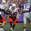 Oklahoma State\'s Brandon Weeden (3) hands the ball off to Kendall Hunter (24) in front of Kansas State\'s Ty Zimmerman (12) during the first half of the college football game between the Oklahoma State University Cowboys (OSU) and the Kansas State University Wildcats (KSU) on Saturday, Oct. 30, 2010, in Manhattan, Kan. Photo by Chris Landsberger, The Oklahoman