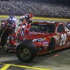 Crew members perform a pit stop on driver Matt Kenseth\'s car during the NASCAR Sprint Cup series Coca-Cola 600 auto race at Charlotte Motor Speedway in Concord, N.C., Sunday, May 26, 2013. (AP Photo/Nell Redmond)