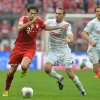 Photo - Bayern's Javier Martinez of Spain, left, and Freiburg's Pavel Krmas of Czech Republic challenge for the ball during the German first division Bundesliga soccer match between FC Bayern Munich and SC Freiburg in Munich, Germany, on Saturday, Feb. 15, 2014. (AP Photo/Kerstin Joensson)