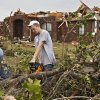 Little Axe students Miguel Varnell and Ben Dodson, from left, help clean up debris and damage on Wednesday, May 12, 2010, in Oklahoma City, Okla. left behind by the tornados that hit central oklahoma on Monday. Varnell and Dodson volunteered their time to help clean up a neighborhood near 59th and Peebly Road after their school was destroyed by a tornado. Photo by Chris Landsberger, The Oklahoman