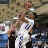 Piedmont\'s Adrion Williams (30) shoots over Clinton\'s Quinton Hand (10) during a basketball tournament at the Kingfisher High School gym on Thursday, Jan. 24, 2013, in Kingfisher, Okla. Photo by Chris Landsberger, The Oklahoman