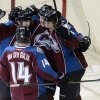 Colorado Avalanche\'s David Van Der Gulik (14), Matt Duchene, left, Jamie McGinn, center, and Erik Johnson celebrate McGinn\'s go-ahead goal in the second period of an NHL hockey game against the Edmonton Oilers in Denver, Saturday, Feb. 13, 2013. The Avalanche won 3-1. (AP Photo/The Denver Post, Andy Cross) MAGAZINES OUT; TV OUT; INTERNET OUT; NO SALES