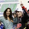 Jeff Gordon, wife Ingrid and son Leo celebrate after Jeff won the NASCAR Sprint Cup auto race at Homestead-Miami Speedway, in Homestead, Fla., Sunday, Nov. 18, 2012. (AP Photo/J Pat Carter)
