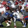 OU\'s Keith Ford (21) fumbles during of the college football game between the University of Oklahoma Sooners (OU) and the University of Kansas Jayhawks (KU) at Memorial Stadium in Lawrence, Kan., Saturday, Oct. 19, 2013. OU won 34-19. Photo by Sarah Phipps, The Oklahoman