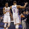 Oklahoma City Thunder\'s Russell Westbrook (0) prepares to slap the hand on Perry Jones (3) after he tipped a shot in for New Orleans during the NBA basketball game between the Oklahoma City Thunder and the New Orleans Hornets at the Chesapeake Energy Arena on Wednesday, Feb. 27, 2013, in Oklahoma City, Okla. Photo by Chris Landsberger, The Oklahoman