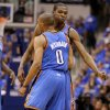 Oklahoma City\'s Russell Westbrook (0) and Oklahoma City\'s Kevin Durant (35) celebrate during Game 3 of the first round in the NBA playoffs between the Oklahoma City Thunder and the Dallas Mavericks at American Airlines Center in Dallas, Thursday, May 3, 2012. Photo by Bryan Terry, The Oklahoman