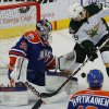 Yann Danis of the Oklahoma City Barons deflects the puck away as Alex Chiasson of the Texas Stars tries to score during an AHL hockey game at the Cox Convention Center in Oklahoma City, Friday, Dec. 21, 2012. Photo by Bryan Terry, The Oklahoman