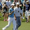 Photo - Rory McIlroy, of Northern Ireland, walks with Jeff Knox, right, down the eighth fairway during the third round of the Masters golf tournament Saturday, April 12, 2014, in Augusta, Ga. (AP Photo/Darron Cummings)