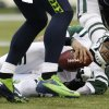 New York Jets quarterback Mark Sanchez lies on the turf after being sacked late in the second half of an NFL football game against the Seattle Seahawks, Sunday, Nov. 11, 2012, in Seattle. The Seahawks won 28-7. (AP Photo/Elaine Thompson)