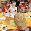 Photo - Morgan Snowden, 9, upper left, a cancer survivor, and Hope Dollarhide, 11, middle, a cancer patient, work on a painting with OSU players Devin Hedgepeth, upper right, and Brandon Weeden, bottom, during a visit by OSU football players to the Jimmy Everest Center for Cancer and Blood Disorders in Children in Oklahoma City, Wednesday, July 14, 2010. Photo by Nate Billings, The Oklahoman  ORG XMIT: KOD