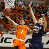 Oklahoma State\'s Cezar Guerrero (1) goes past Texas-San Antonio\'s Igor Nujic (13) during an NCAA college basketball game between the Oklahoma State University Cowboys (OSU) and the University of Texas-San Antonio Roadrunners at Gallagher-Iba Arena in Stillwater, Okla., Wednesday, Nov. 16, 2011. Photo by Bryan Terry, The Oklahoman