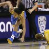 UCLA\'s Mariah Williams, left, stays on her feet after colliding with California\'s Layshia Clarendon as they chased a loose ball in the first half of an NCAA college basketball game in the Pac-12 Conference tournament Saturday, March 9, 2013, in Seattle. (AP Photo/Elaine Thompson)