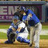 Photo - Chicago Cubs' Starlin Castro, right, hits a double as Los Angeles Dodgers catcher A.J. Ellis catches during the sixth inning of a baseball game, Friday, Aug. 1, 2014, in Los Angeles. (AP Photo/Mark J. Terrill)