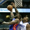 Detroit Pistons\' Jason Maxiell, left, gets off a shot in front of Orlando Magic\'s Glen Davis (11) during the first half of an NBA basketball game, Wednesday, Nov. 21, 2012, in Orlando, Fla. (AP Photo/John Raoux)