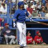 Photo - Toronto Blue Jays' Jose Bautista watches his solo home run off Minnesota Twins relief pitcher Glen Perkins during the fourth inning of a spring training baseball game in Dunedin, Fla., Saturday, March 8, 2014.  (AP Photo/Kathy Willens)
