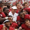 Head coach Bob Stoops and the OU Sooners pose for a photo with the Golden Hat trophy after the Red River Rivalry college football game between the University of Oklahoma (OU) and the University of Texas (UT) at the Cotton Bowl in Dallas, Saturday, Oct. 13, 2012. OU won, 63-21. Photo by Nate Billings, The Oklahoman