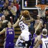 Phoenix Suns forward Luis Scola, left, of Argentina, blocks a shot by Sacramento Kings guard Isaiah Thomas (22) during the first quarter of an NBA basketball game in Sacramento, Calif., Wednesday, Jan. 23, 2013. (AP Photo/Rich Pedroncelli)