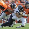 Photo -   Denver Broncos quarterback Peyton Manning (18) is sacked by Houston Texans defensive end J.J. Watt (99) as guard Manny Ramirez (65) defends in the third quarter of an NFL football game Sunday, Sept. 23, 2012, in Denver. (AP Photo/Jack Dempsey)