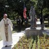Photo - Archbishop Paul Coakley spreads incense from a censer in front of a statue to Saint Kateri Tekakwitha at St. Gregory's Abbey in Shawnee on July 14, 2013. Tekakwitha is the first native American canonized by the Roman Catholic church in October 2012. Photo by KT KING, The Oklahoman